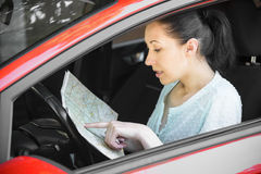 woman-looking-map-vacation-directions-driving-car-54303485